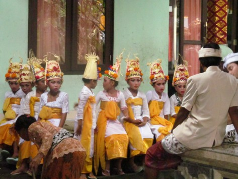 The young dancers. They had been likely dressed since early morning. They, too, were waiting for the ceremony to start.