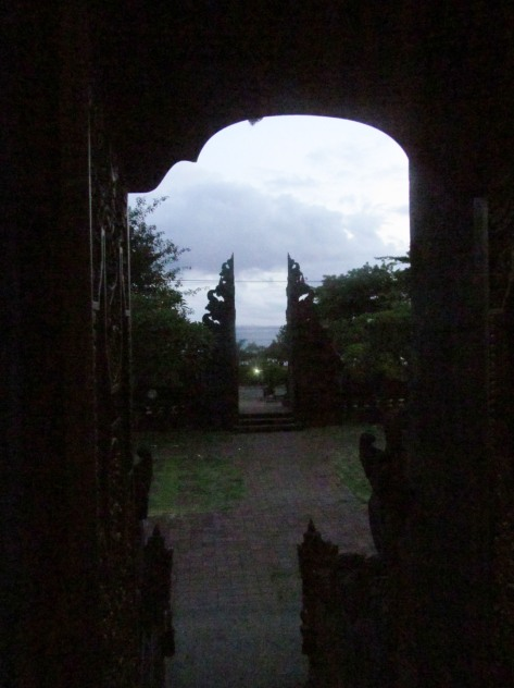 Looking out the temple doors to the sea at dusk.