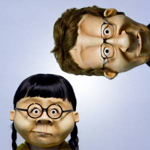 "Two character from ""The Middle of Everywhere"". These masks completely surround the head and are fitted  with accessories like wigs and glasses."