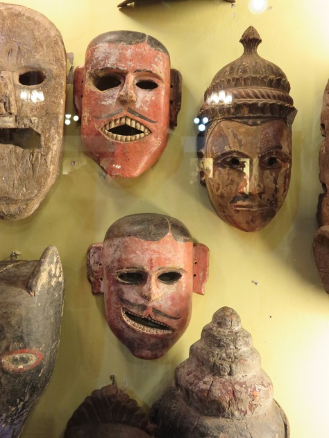 The mask in the lower center, also a ritual mask from Karnataka, seems to build on the basic expression.