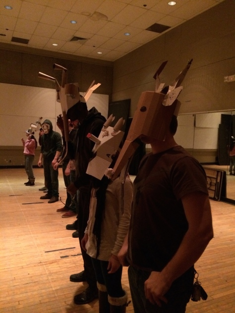 Masks aren't complete until the performer's body is added. We used this as a way to check in on our work as we built.