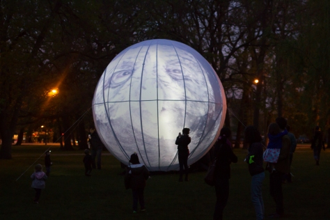 The mask projected on the image of the moon in Humboldt Park, Chicago. Photo ©2015 Kelly Peloza