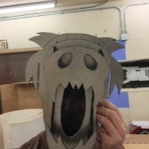 The final bear used coroplast lined with metallic fabric, and scrim covered the open mouth.